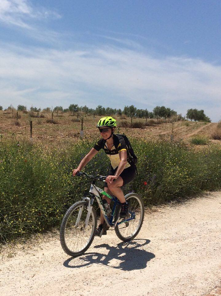 Mountain biking through olive groves